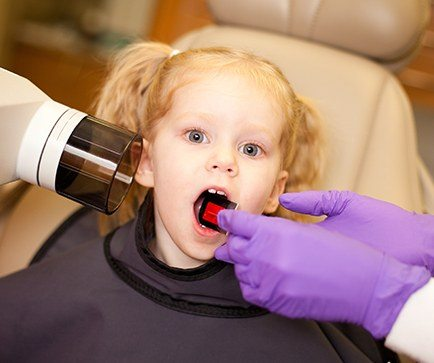 Child receiving dental x-rays