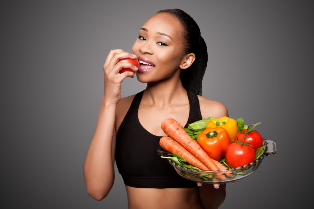 fit woman bowl of healthy snacks
